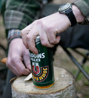 Use a  small piece of wood or stone to set the height of your knife blade and turn the tin to score a line.