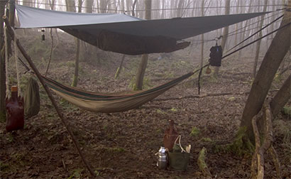 A tarp rigged on the diagonal to shelter a hammock, my usual bushcraft arrangement. - © 2017 - Gary Waidson - Ravenlore